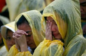 A faithful cries during a mass led by Pope Francis near Tacloban airport
